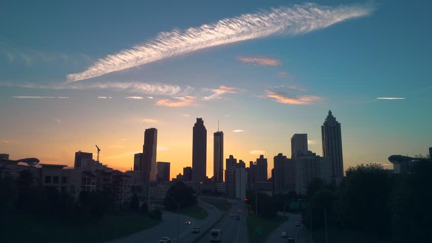 City of Atlanta Skyline Sunset from Jackson St. Bridge | Shutterstock HD Video #1017260935