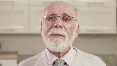 Closeup Portrait Of Old Man. Human emotion.
