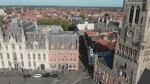 Aerial orbit around the Belfry of Bruges, in Dutch Belfort van Brugge, a medieval bell tower in the centre of Bruges Belgium and one of the citys most prominent symbols.