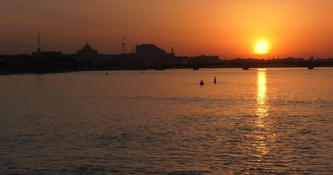 4K high quality video of sunrise in Saint Petersburg, beautiful vintage architecture in city center, majestic palaces, bridges and cathedrals at Neva River embankment of the Russia's northern capital