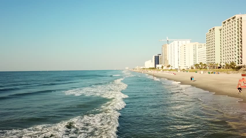 A lovely pan from the ocean waves to the sunny Myrtle Beach.