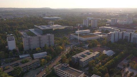 Drone aerial Dresden overview citypark Glaeserne Manufaktur VW Dynamo Stadion sunny sunrise