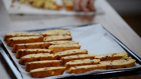 Italian cranberry almond biscotti on a baking tray.