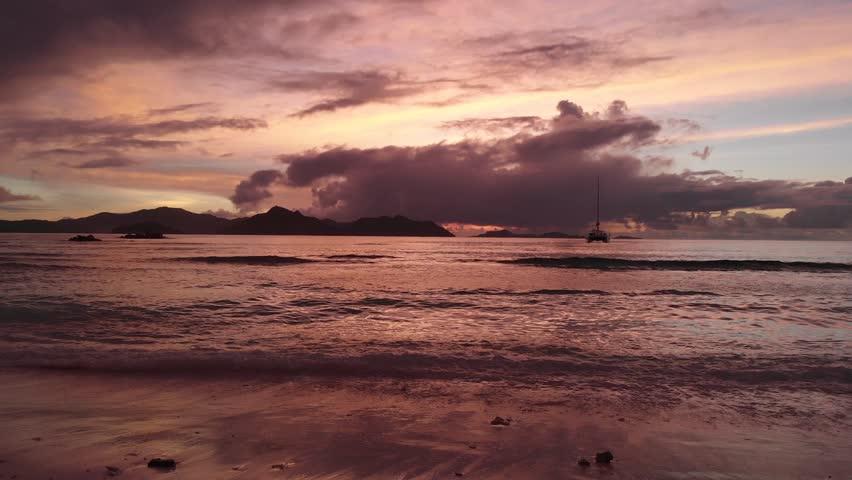 Beautiful sunset on La Digue, an island of the Seychelles. | Shutterstock HD Video #1017403795