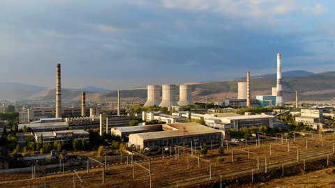 Aerial view of abandoned cooling towers of nuclear power plant at sunrise