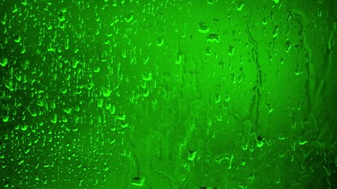 Chroma Key Stock 35 seconds - Close up Water Drops on Glass on a rainy day. 2/2 Green