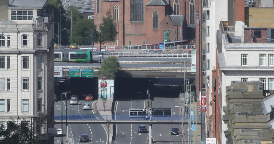 Aerial View of Birmingham with Cars Traffic Jam and Light Rail Tram Passing Day #1017454945