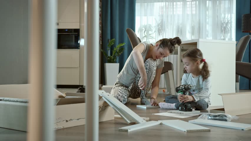 Happy family assembling furniture #1017480595