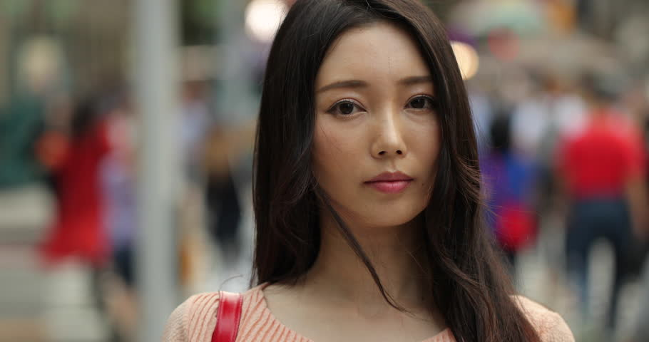 Asian woman in city #1017490015