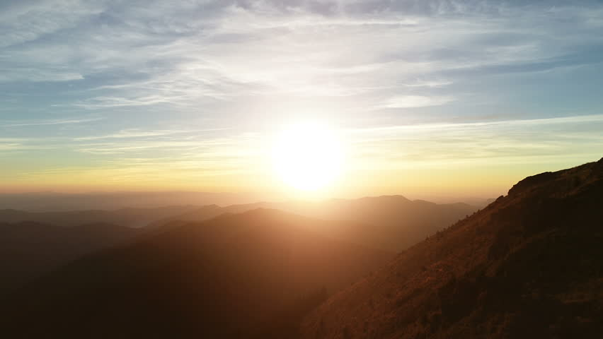 The male standing on the mountain and enjoying the sunrise #1017494305