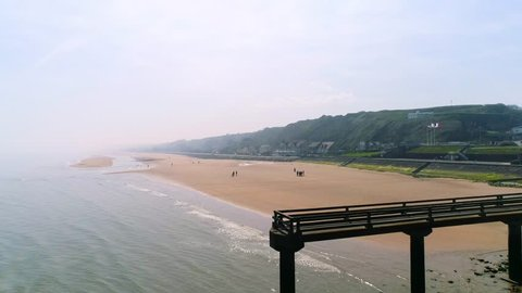 Drone footage - forward aerial shot of Omaha Beach (D-day World War 2) in Normandy France