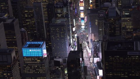 78f452995261a New York City Circa-2015, telephoto aerial view approaching Time Square at  night