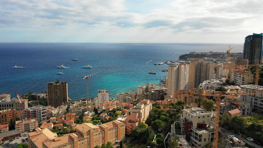 Aerial panoramic view of cityscape of Monte Carlo, famous city by Mediterranean sea skyline - landscape panorama of Monaco from above, Europe | Shutterstock HD Video #1017666055
