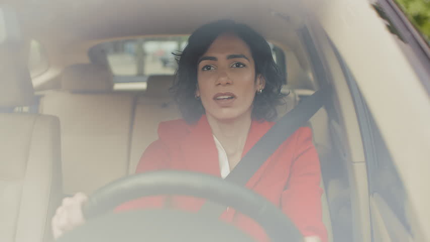 Portrait of Beautiful Young Woman Driving Car through Sunny Suburban Area. Camera Shot Made From the Front Windshield. | Shutterstock HD Video #1017759625
