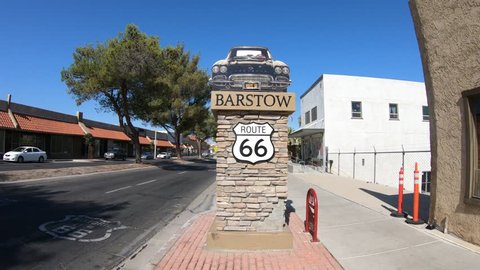 Barstow, California, USA - August 15, 2018: Barstow Sign with 1961 Corvette Convertible along Route 66. Barstow is located in Mojave Desert, san Bernardino County.