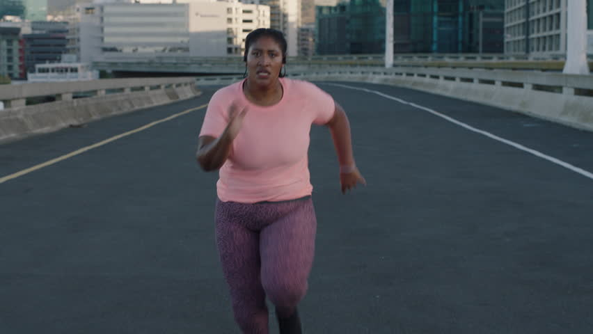Young overweight black woman running resting exhausted after difficult running cardio exercise tired african american female in urban city at sunrise   Shutterstock HD Video #1017906715