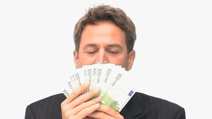 Businessman smelling his money