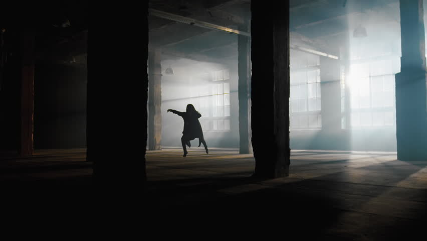 Slow motion dancing girl, dancer performance contemporary modern dance in industrial art space with smog and strong backlight from large windows | Shutterstock HD Video #1017951355