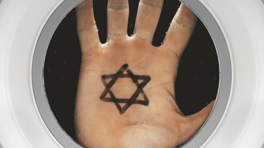 Hand with a symbol on the palm: Star of David, appears in the porthole from the dark depths, close-up | Shutterstock HD Video #1017978115