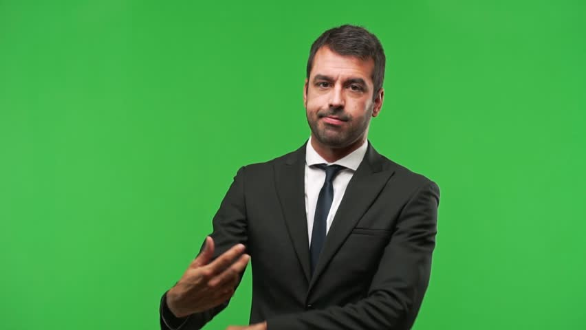 Businessman on green screen chroma key background making the gesture of madness putting finger on the head | Shutterstock HD Video #1018064095