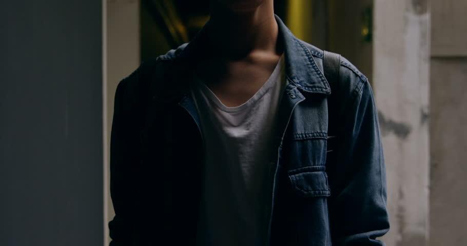 Portrait of young man standing in corridor 4k