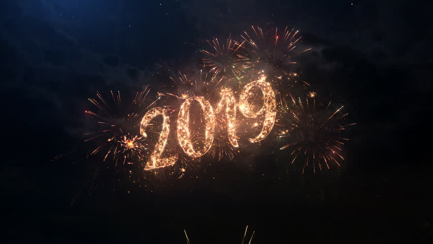 2019 Happy New Year greeting text with particles and sparks on black night sky with colored slow motion fireworks on background, beautiful typography magic design. | Shutterstock HD Video #1018126135