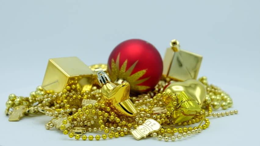 Golden Christmas decoration and red ball with star rotating on white background. Footage ready for loop. | Shutterstock HD Video #1018159435