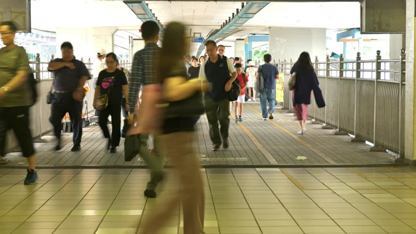 Timelapse of people moving along walk way in Hong Kong. | Shutterstock HD Video #1018164775
