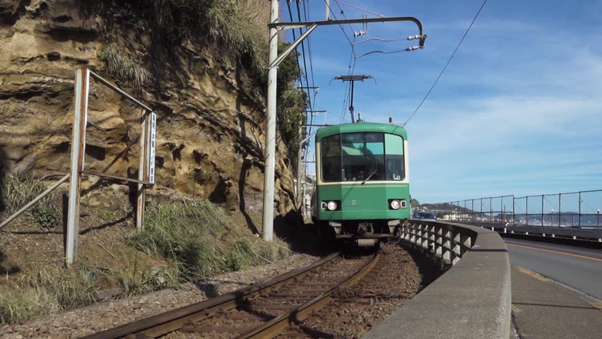 Enoden tram at the sea side | Shutterstock HD Video #1018173445