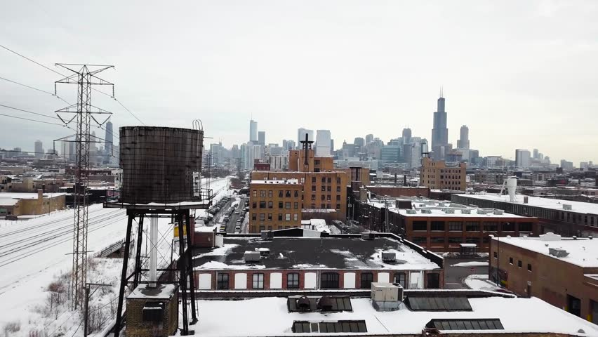 Aerial shots of winter industrial Chicago with view on skyscrapers, train and buildings