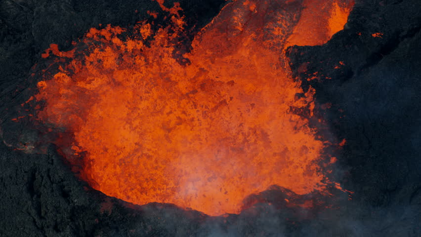 Aerial view open fissures ejecting rivers of hot magma toxic gases from earths mantle destroying property lava rock solidifying Kilauea Hawaii USA RED WEAPON