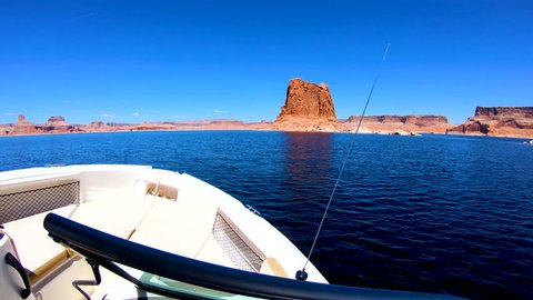POV of tourist boat cruising Lake Powell an American summer vacation resort in the Wilderness remote sandstone cliffs amid clear waters Utah Arizona USA