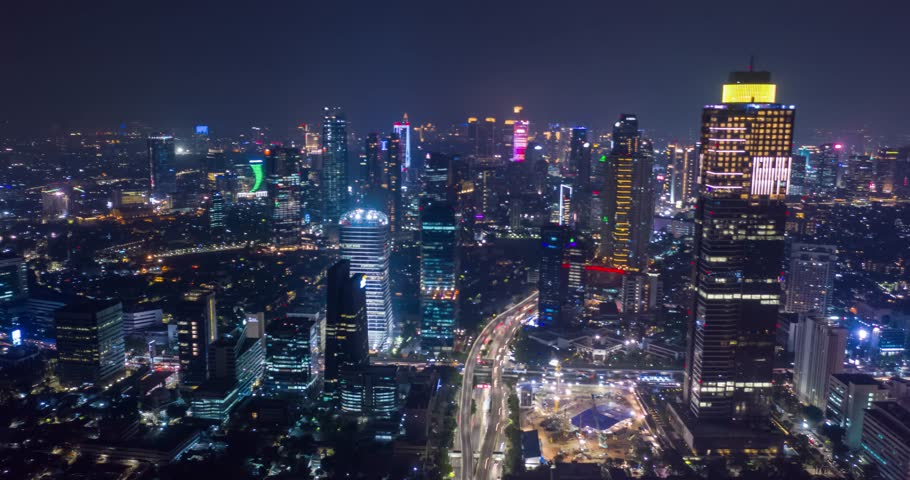 JAKARTA, Indonesia - October 23, 2018: Beautiful aerial hyperlapse/time-lapse of Jakarta cityscape with skyscrapers and light trails on the street at nighttime. Shot in 4k resolution | Shutterstock HD Video #1018520305