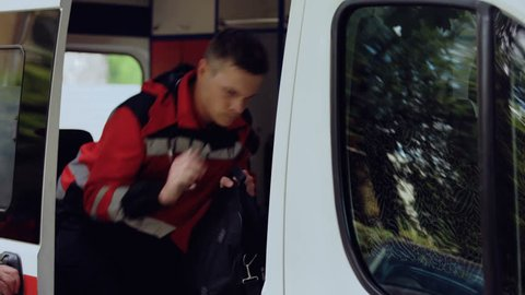 Ambulance crew gets into transport, ready to save lives, responds to call out
