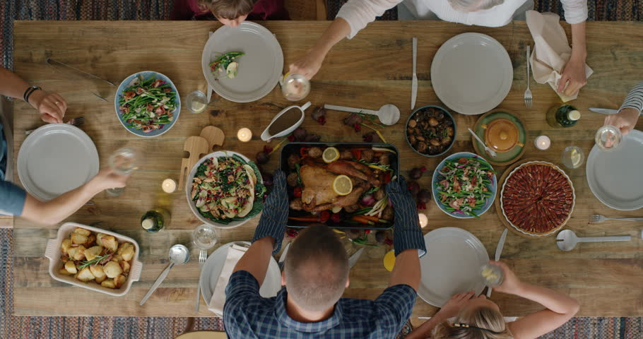 Happy family enjoying thanksgiving lunch together enjoying healthy homemade feast holiday celebration holiday meal overhead tracking | Shutterstock HD Video #1018898245