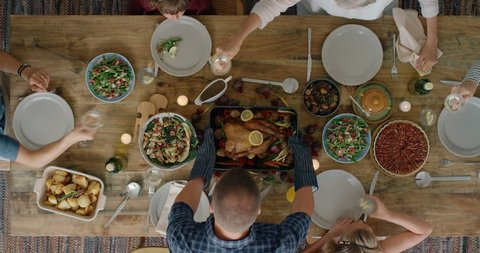 happy family enjoying thanksgiving lunch together enjoying healthy homemade feast holiday celebration holiday meal overhead tracking