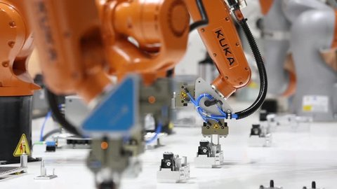 Hannover, Germany - April, 2018: Robot arms on Kuka stand on Messe fair in Hannover, Germany