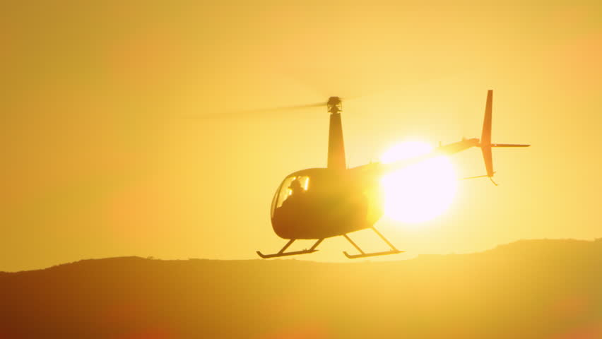 Aerial view of helicopter flying over mountains into the clouds during magical sunset in Los Angeles, California. Wide long shot on 4K RED camera. | Shutterstock HD Video #1019021905