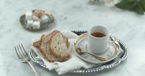 Fancy English tea and cake served on silverware closeup with 4k Phantom Flex camera