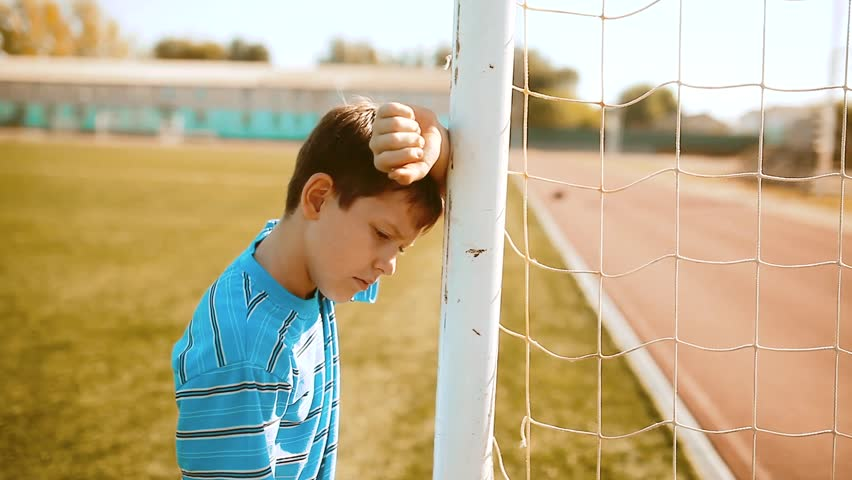 Boy teenager soccer football player upset defeat insult sadness and anger. boy teenager grieved after the defeat. lifestyle well, managed to win. soccer kids concept | Shutterstock HD Video #1019161075