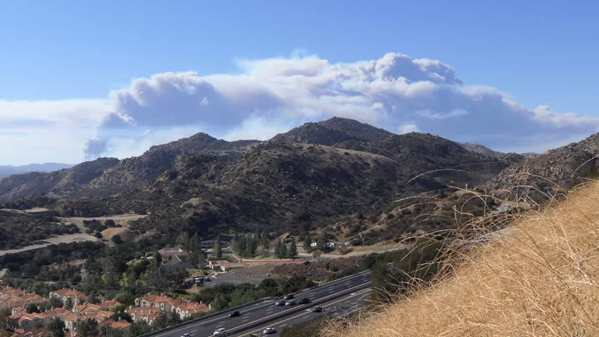 Los Angeles, California, USA - November 9, 2018:  Time lapse view of billowing smoke from Woolsey fire in Thousand Oaks, Simi Valley, Westland Village and Malibu.   Shutterstock HD Video #1019208205