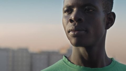 pride, ethnicity, minority.proud young African man looks at the horizon