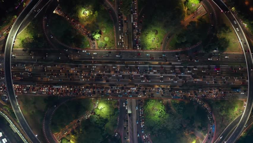 Top down view of traffic jam during rush hour at night on Semanggi highway interchange in Jakarta city, Indonesia. Shot in 4k resolution | Shutterstock HD Video #1019248405