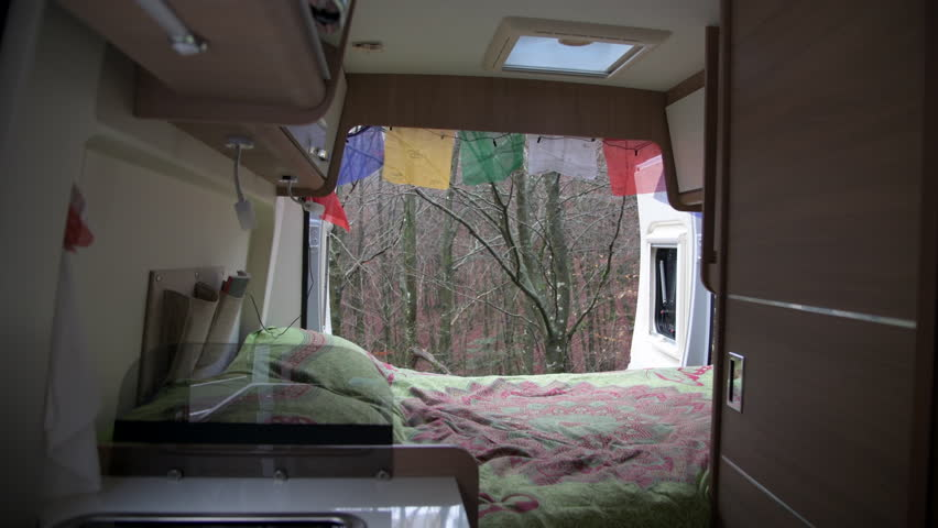 Forest view through interior of a camper van | Shutterstock HD Video #1019363755