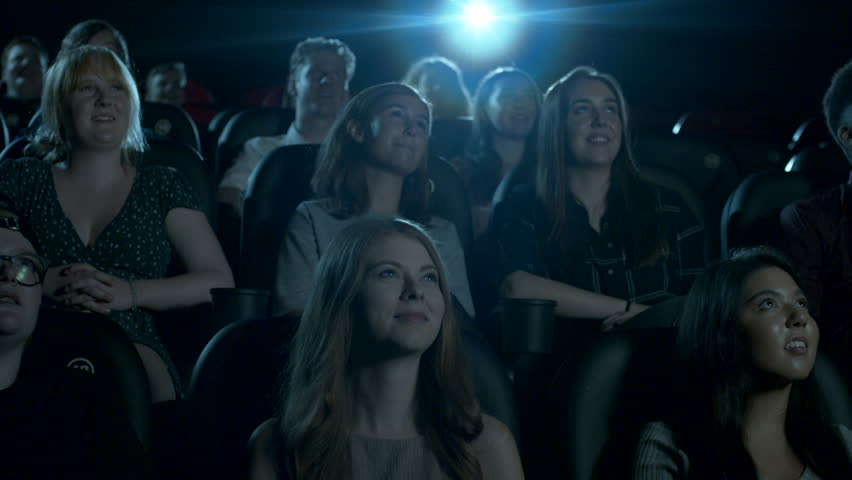 Smiling and laughing movie theatre audience. Dolly left and right. | Shutterstock HD Video #1019435635
