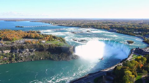 Niagara Falls wide angle panorama, with cruise boat and Horseshoe Falls in autumn. Overhead view.