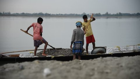 Barpeta, Assam, India, November 15, 2018. Labour carrying  extracted  sand and rocks from Beki River in  Barpeta,  in Assam.