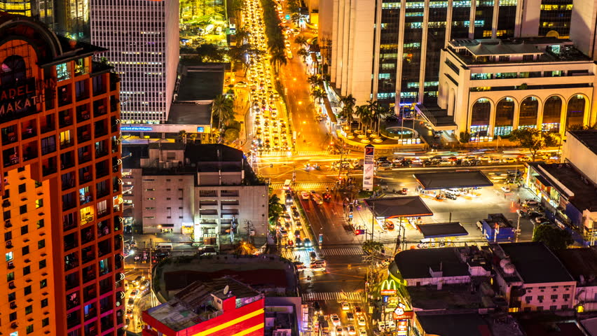 METRO MANILA, PHILIPPINES - CIRCA MARCH 2018: Time-lapse view on the traffic of a busy crossroad in Makati at night circa March 2018 in Metro Manila, Philippines.  | Shutterstock HD Video #1019611375