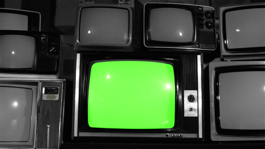 """80s TV Green Screen over Stacked 80s TVs. Dolly Out. Noir Tone. You can Replace Green Screen with the Footage you Want with """"Keying"""" effect in After Effects (check out tutorials on YouTube). 