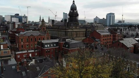 Leeds Town Hall aerial footage over looking the whole of the Leeds City Centre in West Yorkshire in the UK